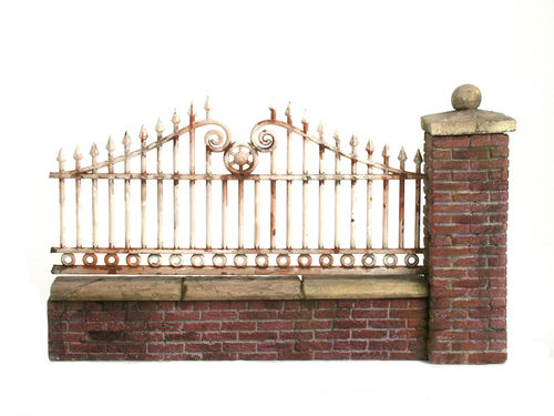 Brickwall with fence extension