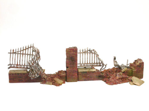 Brickwall with fence rubble